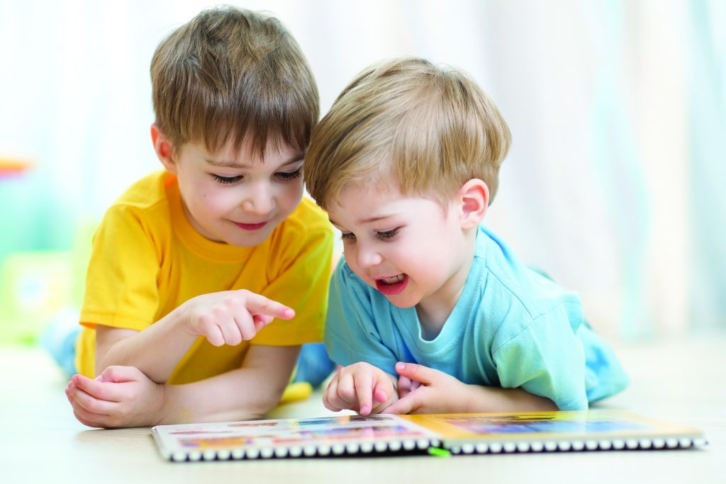 Kids Brothers Practice Reading Together Looking At Book Laying O