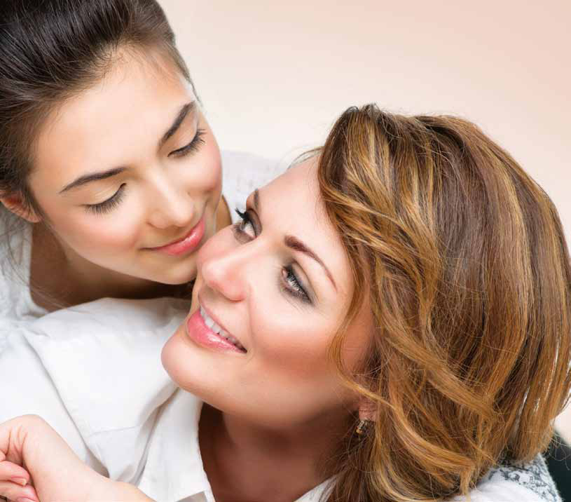 Mother and Teen Daughter. Close-up portrait of attractive happy