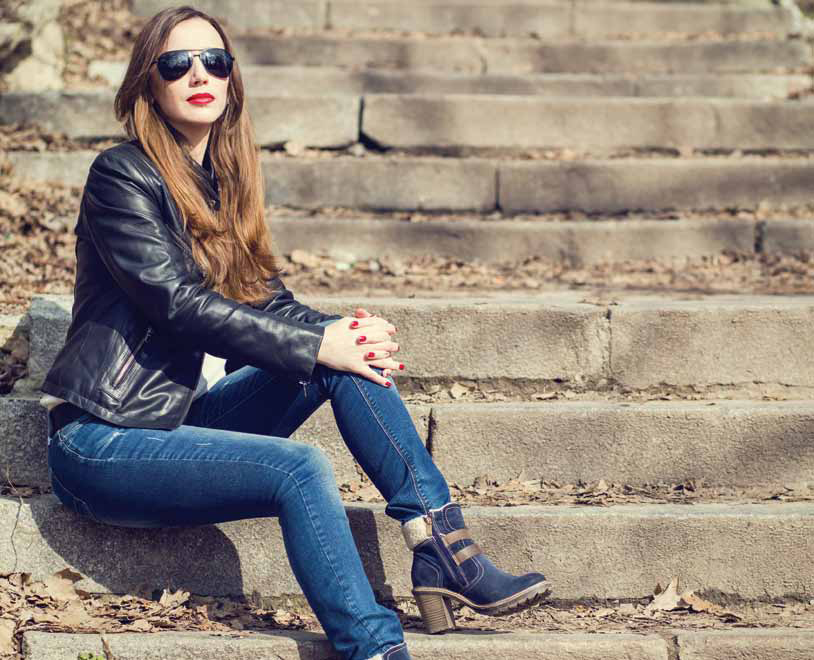 Young Woman In Leather Jacket Resting On Stairs