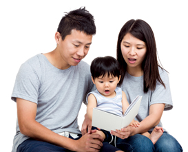 Young couple reading book with baby boy