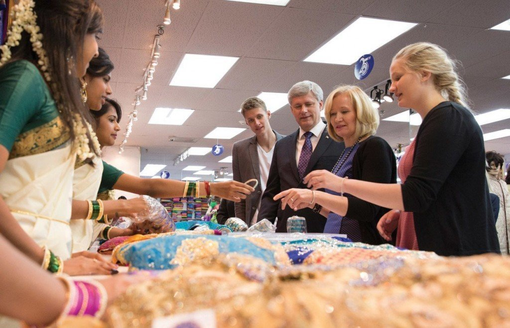 Prime Minister Stephen Harper visits a textiles store in Scarborough, Ontario August, 10, 2015. CPC Photo by Jason Ransom
