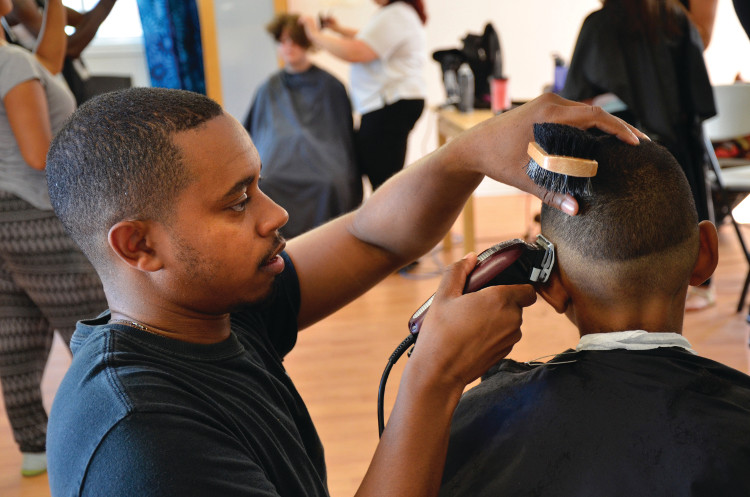 Barber Danny Brown of Hairfellas Barbershop at Morrison Gardens Community House. Photo: Precia Miljouy