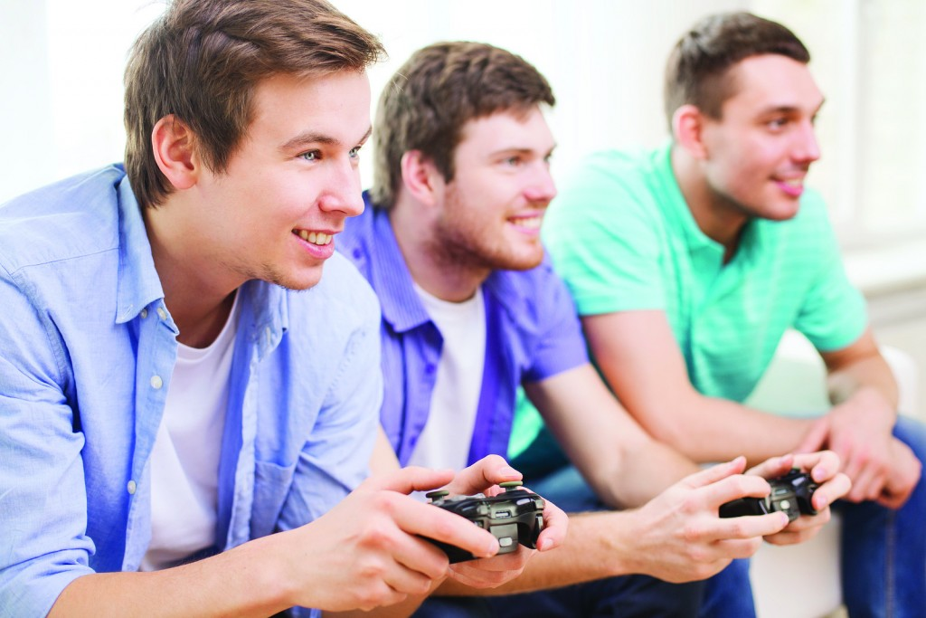 friendship, technology, games and home concept - smiling male fr