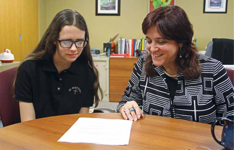 Grade 11 St. Matthew High School student Ashley Robitaille reviews her course selections for the coming year with principal Debbie Clark. St. Matthew's co-op program is giving Ashley the opportunity to explore diverse interests before she graduates.